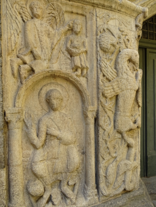 Romanesque carving on the exterior of the Basilica of San Fedele.